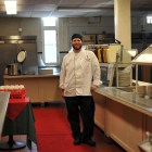 A Cornell Dining chef stands in Risley Dining Hall.
