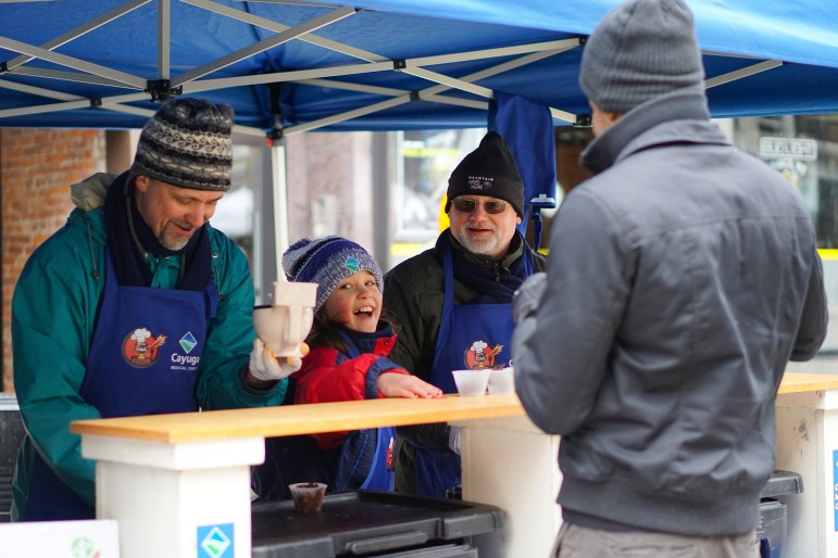 Attendees are served warm chili during the cook-off in downtown Ithaca.