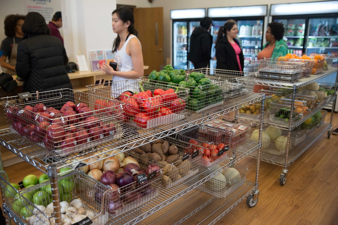 Students shop around the aisles of Anabel's Grocery.