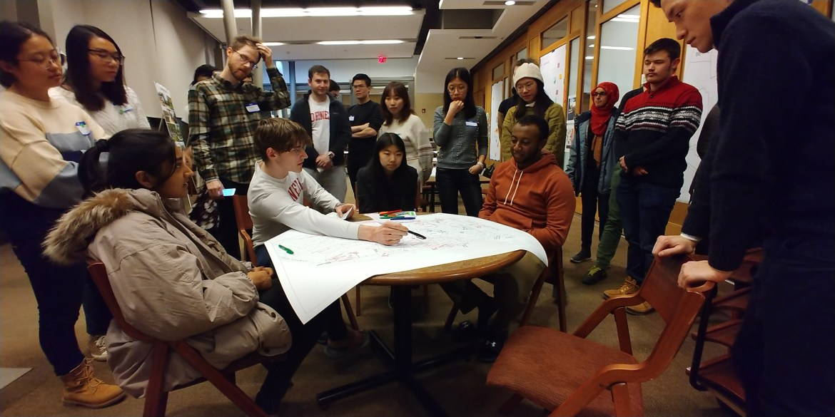 Cornell students meet to discuss West 6.0, an initiative to develop the spaces between the five West Campus houses.