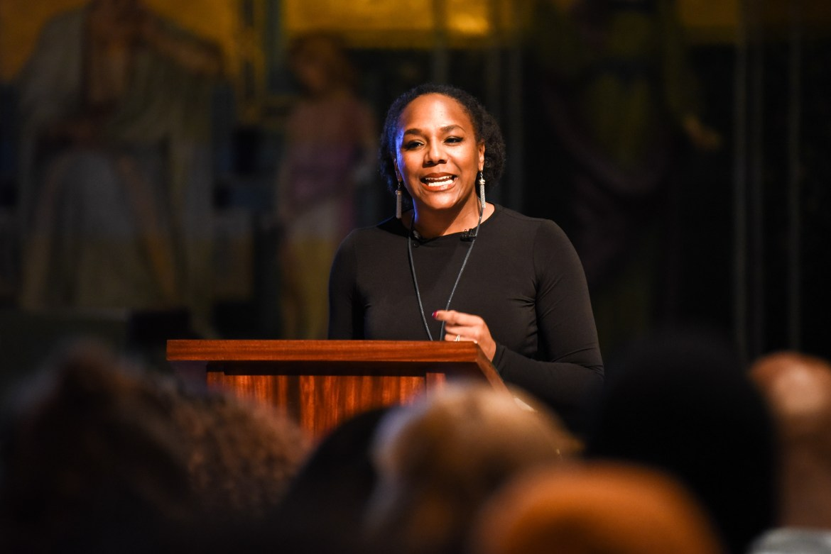 Bree Newsome speaks in Sage Chapel at Cornell on Monday. She reflected on the legacy of the Rev Dr. Martin Luther King Jr. and also on her climb to the top of a flagpole in 2015 to remove a Confederate flag from above the South Carolina statehouse.
