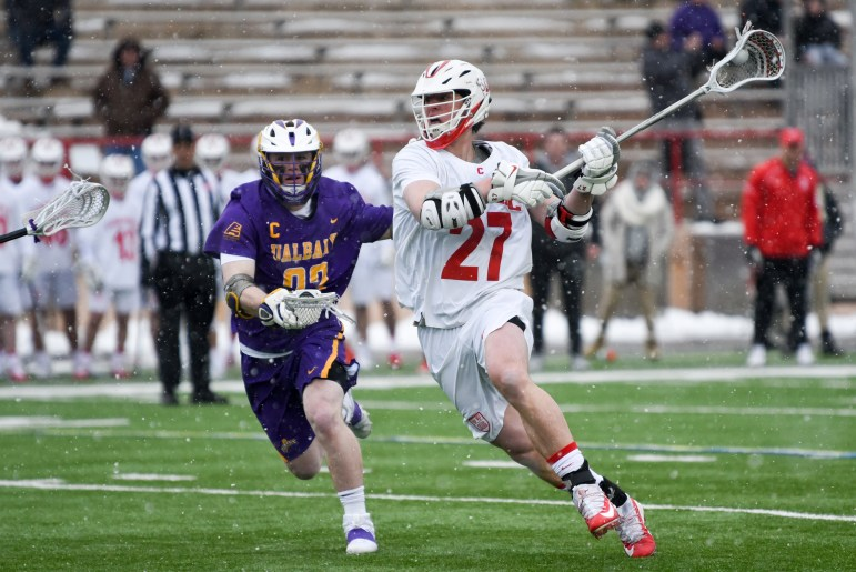Junior midfielder Connor Fletcher lines up a shot at the men's lacrosse game against Albany. Fletcher scored the game-winning goal with under 14 seconds left to play, giving the Red its first win over Albany in four years. (Boris Tsang / Sun Photography Editor)