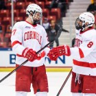 Morgan Barron and Yanni Kaldis congratulate one another after linking up on a power play against Brown.