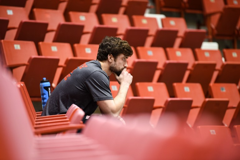 Senior defenseman Matt Nuttle sits in silence before the ECAC championship game on Saturday. The Red lost the final against Clarkson, 3-2, in overtime. (Boris Tsang / Sun Photography Editor)