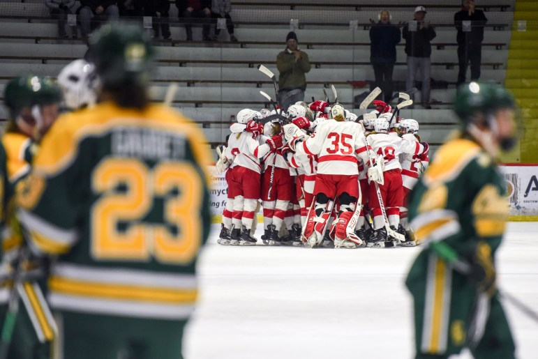Cornell celebrates its December win over Clarkson.
