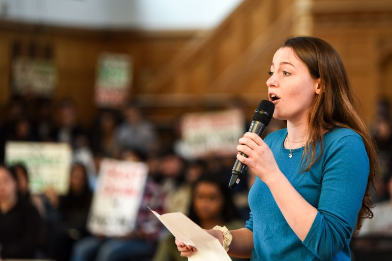 An opponent of divestment speaks at the S.A. meeting on Thursday.