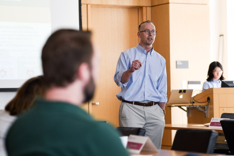 Craig Wiggers, chair and veterans' representative at-large, speaks at the Employee Assembly meeting on Wednesday. Wiggers discussed the key issues identified by Leading Cornell, a leadership program for Cornell employees, that staff at Cornell face, including housing, community and well-being. (Boris Tsang / Sun Photography Editor)