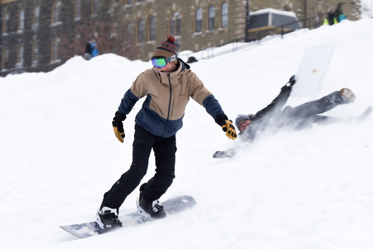 As snow descends on campus, grab a snowboard, a pair of skis, or even a flattened cardboard box and slide (or tumble) down Libe Slope.