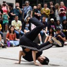 A member of the Absolute Zero breakdance crew strikes a pose during his turn in front of the crowd. (Boris Tsang/Sun Photography Editor)