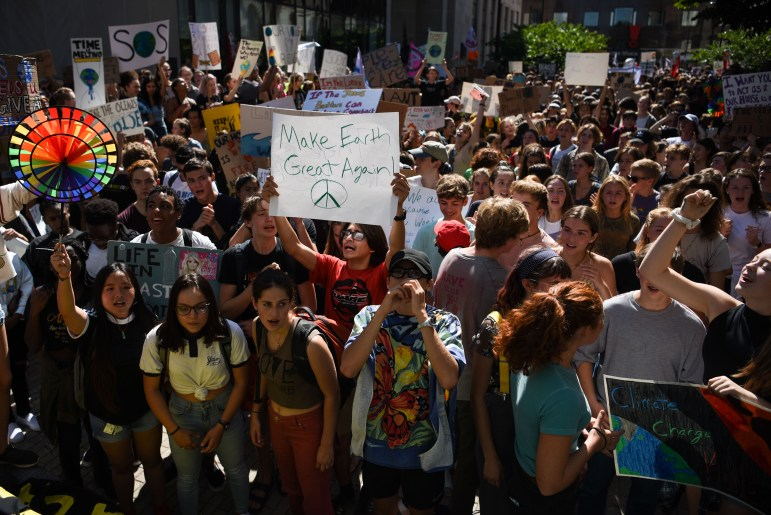 Protesters from Cornell took part in a larger rally at the Commons, where crowds grew to nearly 1500 people. (Boris Tsang/Sun Photography Editor)
