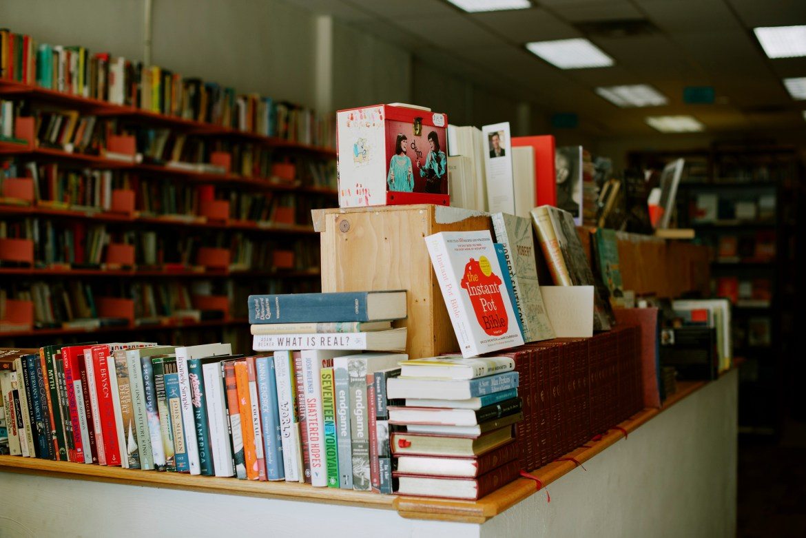 """Books on display at Amazing Books & Records in Pittsburgh, Aug. 1, 2019. At a shop that at times functioned as a sanctuary after the Tree of Life shooting, the owner sees his job as """"a moral obligation."""" (Kristian Thacker/The New York Times)"""