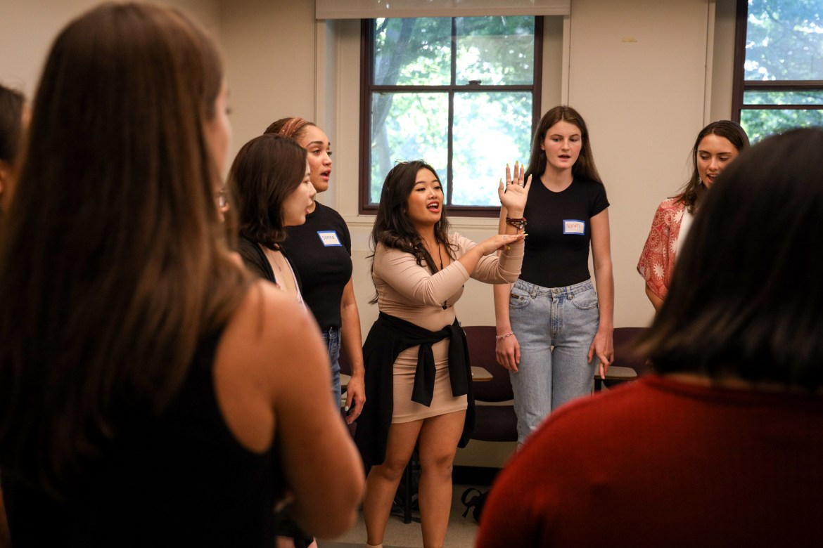 Maxine Malvar '21, assistant musical director of the Touchtones, instructing prospective members during auditions.