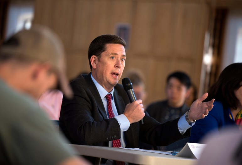 Ryan Lombardi, vice president for student and campus life, answers a question at the S.A. meeting. (Daniel Ra/Sun Staff Photographer)