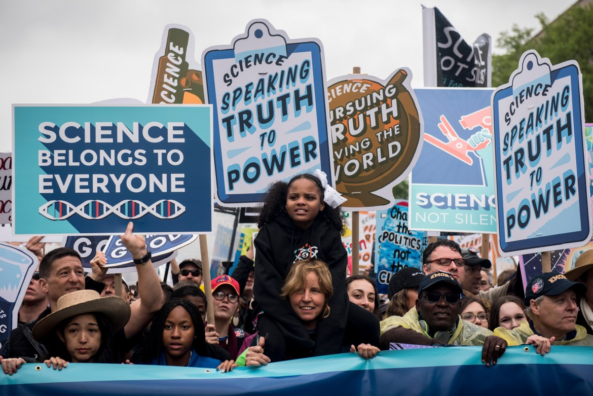 People gather at the Washington Monument before participating in the March for Science on Earth Day.