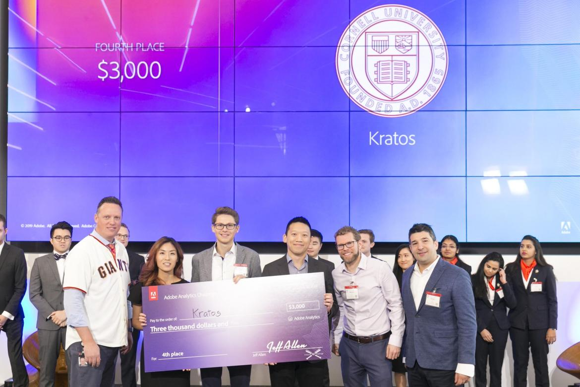 Cornell Tech students Cassie Dai, Fabio Daiber, and Erik Chen (holding the check from left to right) are presented with $3000 in prize money after finishing 4th place at the Adobe Analytics Challenge.