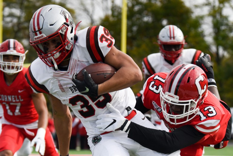 Sophomore defensive back Jalyx Hunt goes in for the tackle at the game against Brown on Saturday. The Red claimed its first Ivy League victory with the thrilling 37-35 win. (Boris Tsang/Sun Photography Editor)