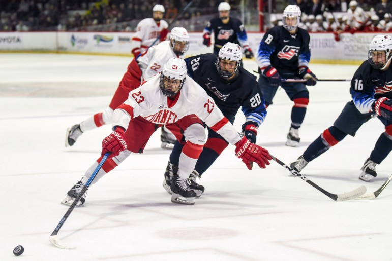 Sophomore forward Liam Motley fights for control of the puck at the preseason game against the U.S. National Team Development Program's Under-18 team on Saturday. A solid performance earned the Red a 3-0 victory before its first regular season game next Friday. (Boris Tsang/Sun Photography Editor)