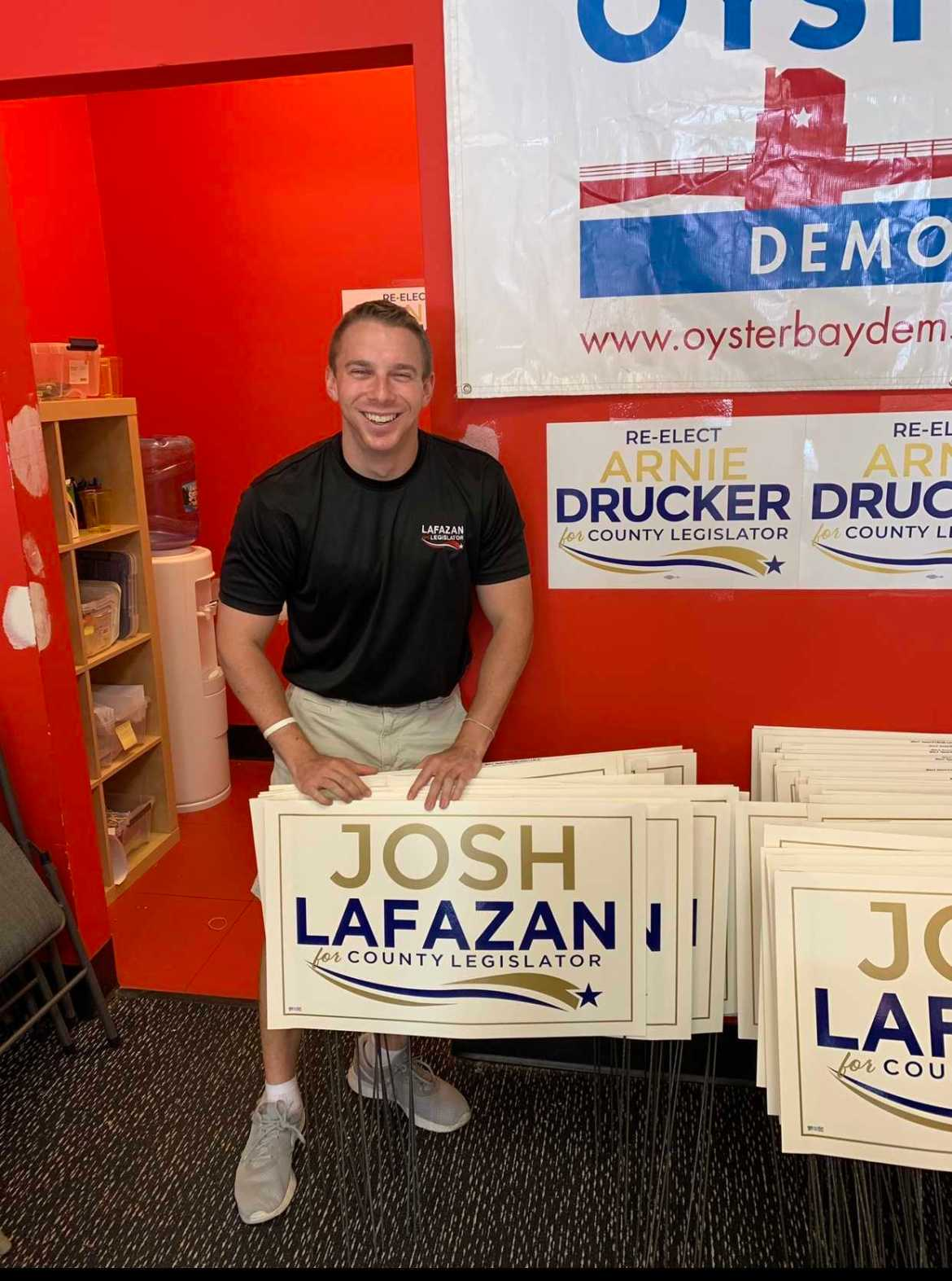 Josh Lafazan '16 poses with campaign posters. Lafazan became one of New York's youngest politicians when he won his race for a seat in the Nassau County Legislature at age 23.