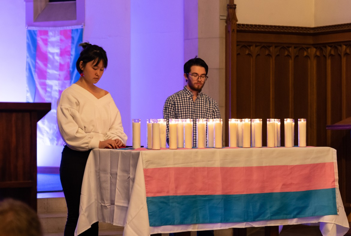 Students light candles representing lives lost in the past year at the Transgender Remembrance Vigil.