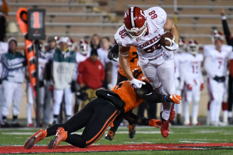 Senior tight end John Fitzgerald is tackled by a Princeton defensive back at the football game on Friday. The Red's offense struggled throughout the night, leading to a 21-7 loss. (Boris Tsang/Sun Photography Editor)
