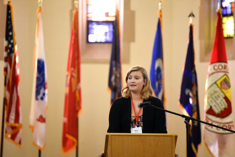 Maria Wood, daughter of Captain George Wood '93, speaks at the war memorial dedication in the chapel of Anabel Taylor Hall on Saturday. The names of Captain George Wood '93 and Major Richard Gannon '95 were added to the war memorial in the rotunda after the two died while serving in Iraq. (Boris Tsang/Sun Photography Editor)