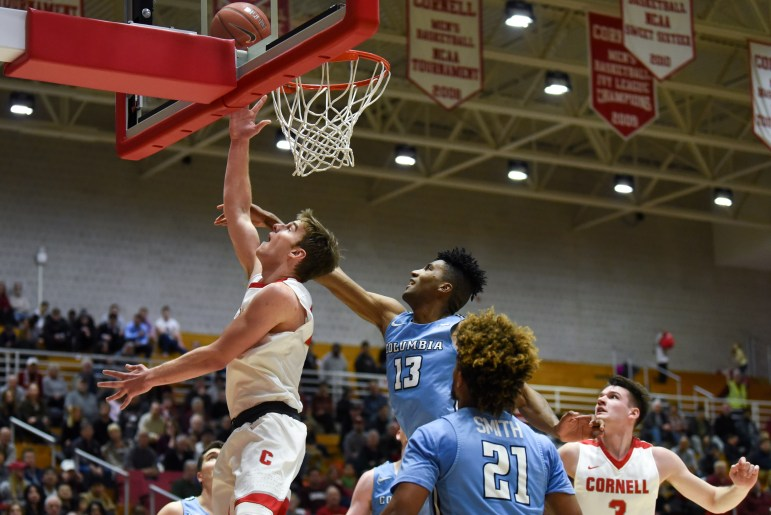 Senior forward Josh Warren puts up a shot at the men's basketball game against Columbia on Saturday. The Red claimed a 62-50 victory over the Lions. (Boris Tsang/Sun Photography Editor)