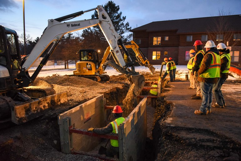Construction on a water main break on Jessup Road continues on Tuesday night. The break forced the closure of parts of Jessup Road, rerouting TCAT routes with stops through Jessup at Pleasant Grove. (Boris Tsang/Sun Photography Editor)