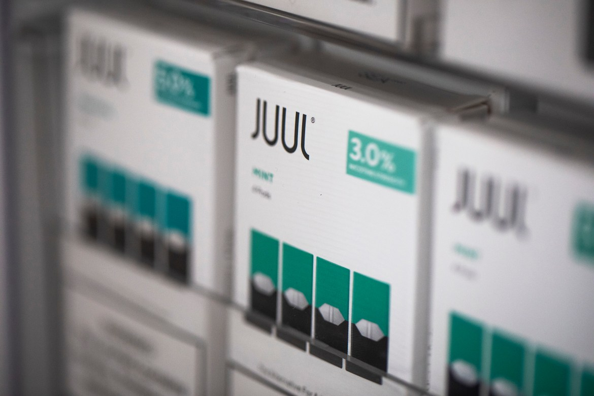 Juul products at a vaping store in the East Village of New York, Aug. 1, 2019. The Trump administration confirmed Thursday, Jan. 2, 2020, that it will forbid the sale of most flavored electronic cigarette cartridges, but exempted the open tank systems sold in vape shops that permit custom mixing of flavors.