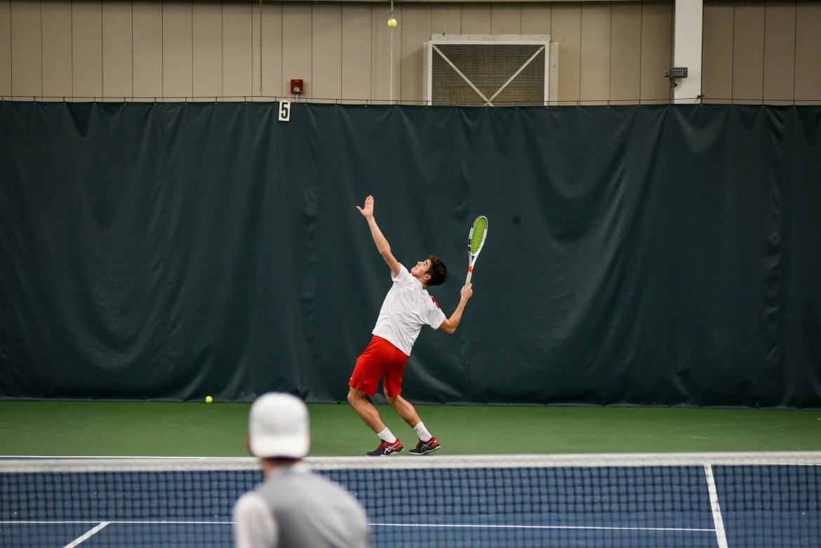 Senior Lev Kazakov pushed the Red to its perfect score, clinching wins in both doubles and singles.
