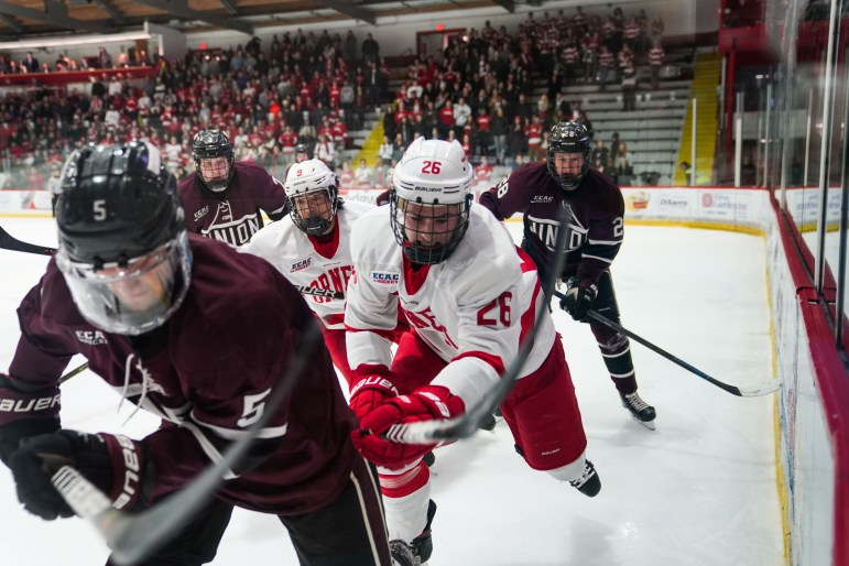 Junior forward Tristan Mullin, a junior, sprints at the hockey game against Union on Friday. The Red won 5-2. (Ben Parker/Sun Assistant Photography Editor)