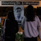 Chinese citizens pay respects at a shrine to Dr. Len Wenliang.