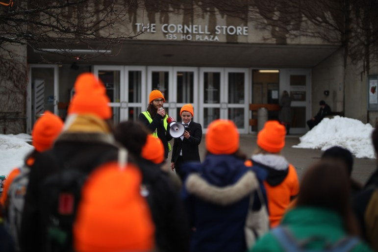 Surrounding the Cornell Store, students protested Cornell's investment in fossil fuels on Thursday. Across the country, college students participated in Global Divestment Day, protesting for fossil fuel divestment and climate change initiative. (Michael Wenye Li/Sun Senior Photographer)