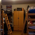 """A bed is stacked on top of another in first-year """"forced triple"""" rooms."""