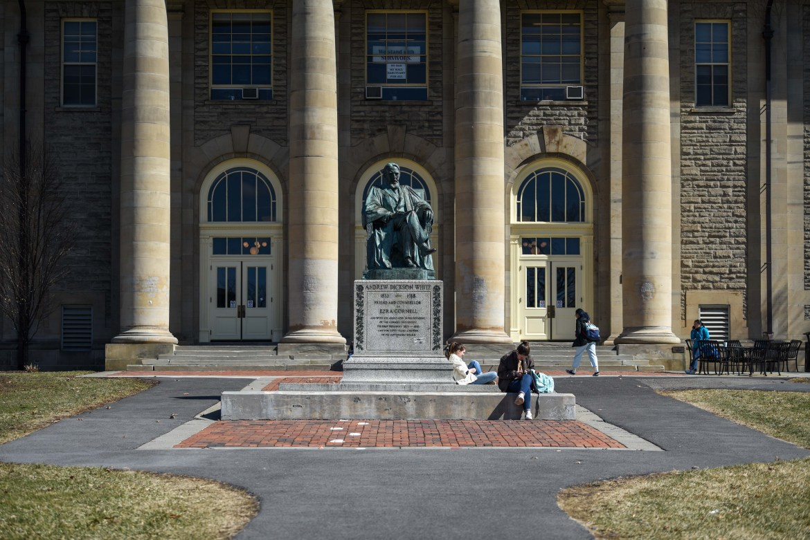 A few students take advantage of the sunny weather to sit outside on the Arts Quad on March 13, 2020 amid widespread concern over the COVID-19 pandemic.