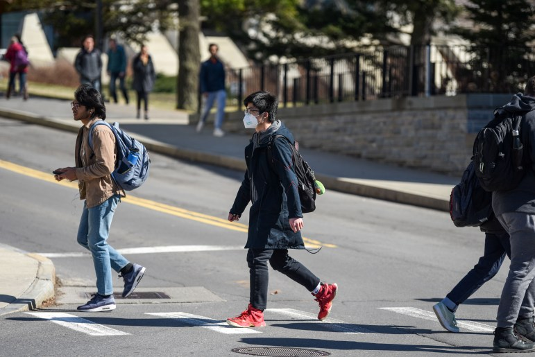 A student wears a mask as concerns over the COVID-19 outbreak grow on March 13, 2020.