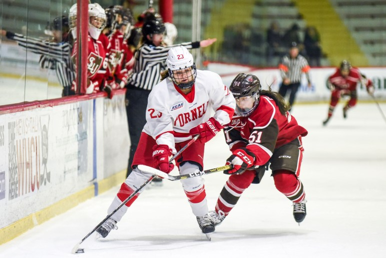 Junior forward Finley Frechette accelerates the puck at the women's hockey game against St. Lawrence on Saturday. (Boris Tsang/Sun Photography Editor)