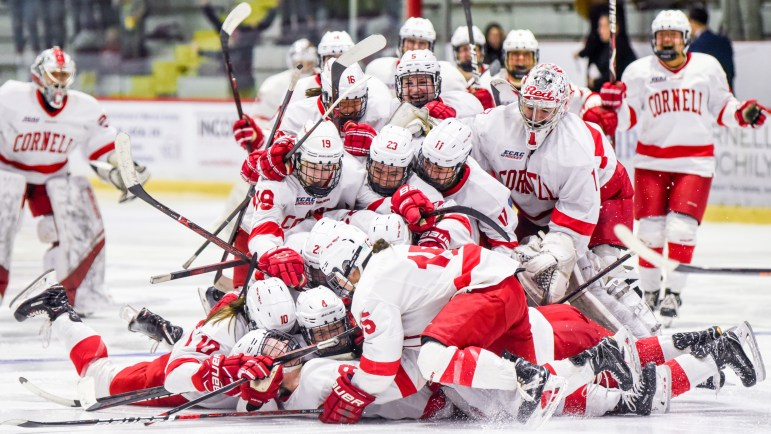 The Cornell women's hockey team piles on top of defenseman and captain Micah Zandee-Hart after her double overtime goal in the ECAC semifinals against Princeton at Lynah Rink on March 9, 2019. The 3-2 comeback victory sent the Red to its first ECAC championship game since 2014.