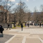 Students walk down Ho Plaza on Friday afternoon after the University's announcement that classes were suspended effective at 5 p.m.