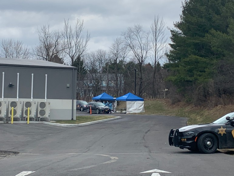 The testing site's exit, flanked by a Tompkins County Sheriff's Department Car.
