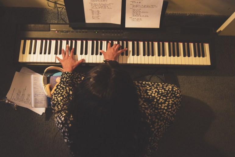 Abi Bernard '19, at work on her keyboard.