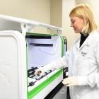 Rheonix employee testing samples.