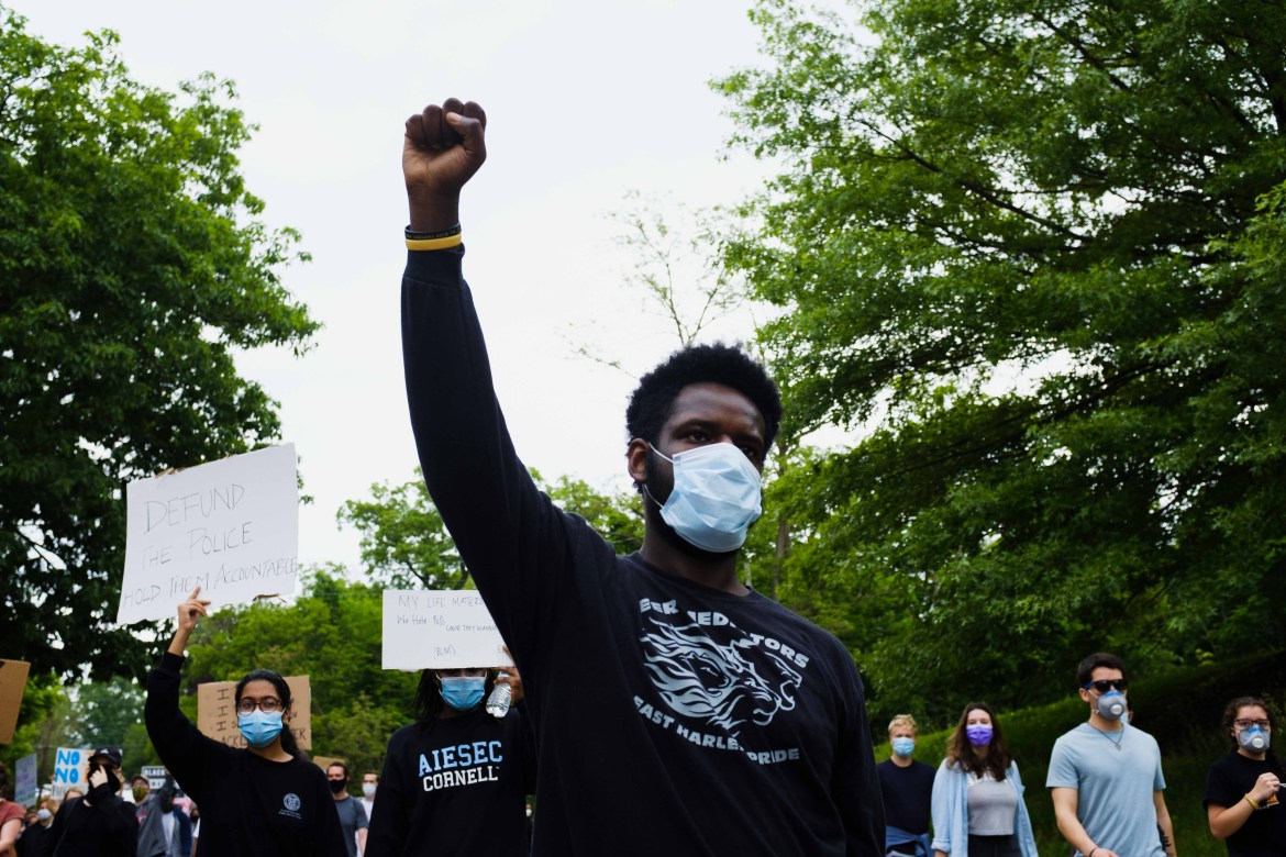 A student protests against police brutality in Ithaca on June 2. Not all students are in Ithaca, but many Cornellians are joining Black Lives Matter protests in their hometowns.