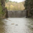 A man fell into a 30-foot dam on Six Mile Creek on Sunday.