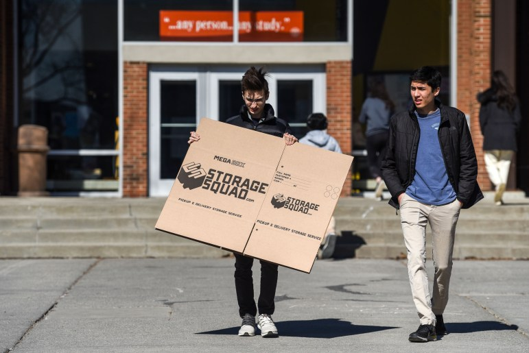 Students pick up cardboard boxes at RPCC on March 15, 2020.