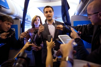 Robby Mook, presidential candidate Hillary Clinton's campaign manager, speaks to reporters on board the campaign plane in White Plains, N.Y., as it heads to Iowa for a rally, Oct. 28, 2016. James Comey, the director of the FBI, has alerted Congress of newly-uncovered emails that appear to be pertinent to the closed investigation of whether then-Secretary of State Clinton or her aides had mishandled classified information. Behind Mook is Jennifer Palmieri, communications director.