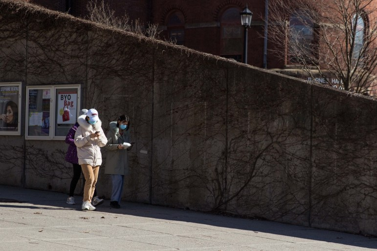 Student leave the Cornell Store wearing masks on March 13, 2020.