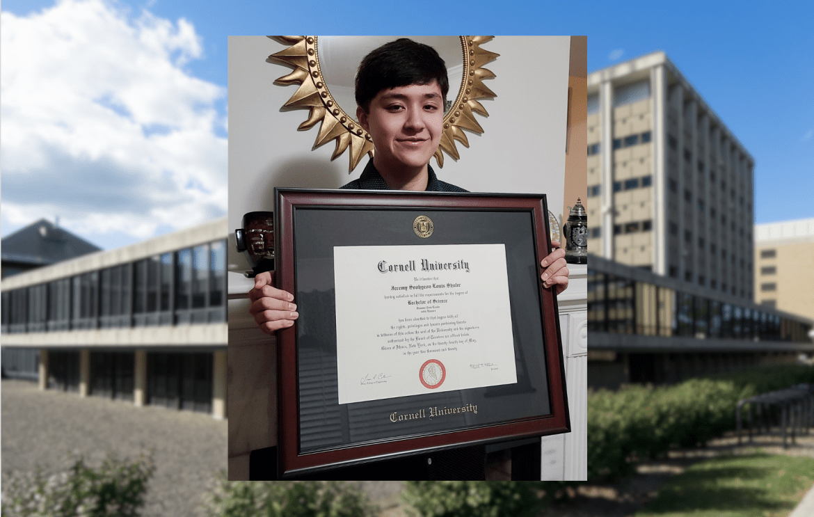 Jeremy Shuler with his Cornell diploma.