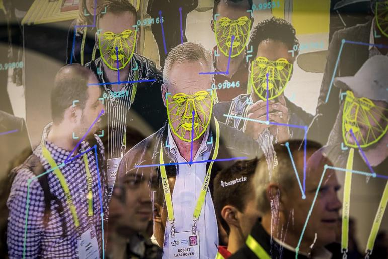Attendees interact with a facial recognition demonstration during the Consumer Electronics Show in Las Vegas, Jan. 8, 2019.