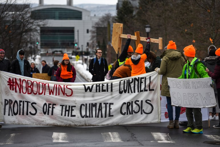 Climate Justice Cornell protesters gather at the intersection of Tower Road and East Avenue on Feb. 13, 2020.