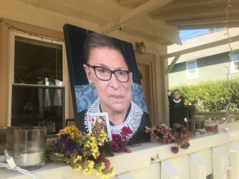 A makeshift shrine in front of a Collegetown apartment sports a portrait of the late justice in her infamous dissenting collar.